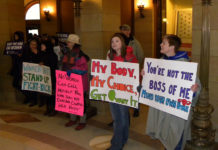 """""""Minnesotans Unite Against the War on Women in the capitol"""" by Fibonacci Blue is licensed under CC BY 2.0"""